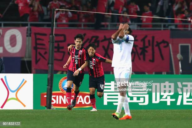 Kenyu Sugimoto of Cerezo Osaka celebrates scoring his side's second goal with his team mate Mizuki Ando during the AFC Champions League Group G game...