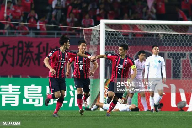 Kenyu Sugimoto of Cerezo Osaka celebrates scoring his side's second goal with his team mates Mizuki Ando and Hotaru Yamaguchi during the AFC...