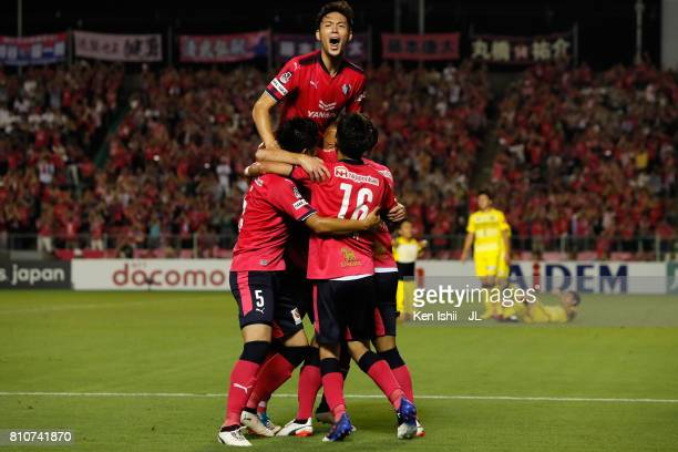 Kenyu Sugimoto of Cerezo Osaka joins the celebration as Souza of Cerezo Osaka scores his side's second goal during the JLeague J1 match between...