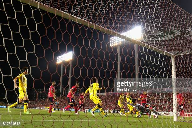 Kenyu Sugimoto of Cerezo Osaka scores his side's first goal past Kosuke Nakamura of Kashiwa Reysol during the J.League J1 match between Cerezo Osaka...
