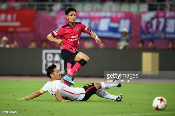 Kenyu Sugimoto of Cerezo Osaka shoots at goal while Yuki Abe of Urawa Red Diamonds tries to block during the JLeague J1 match between Cerezo Osaka...