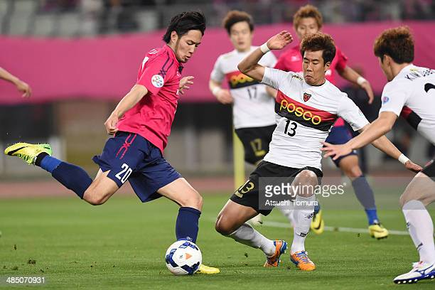 Kenyu Sugimoto of Cerezo Osaka takes a shot on goal while Kim Won Il of Pohang Steelers tries to block during the AFC Champions League Group E match...
