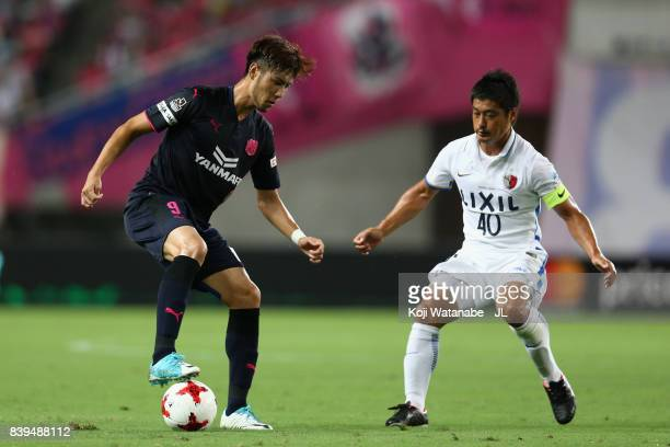 Kenyu Sugimoto of Cerezo Osaka takes on Mitsuo Ogasawara of Kashima Antlers during the JLeague J1 match between Cerezo Osaka and Kashima Antlers at...