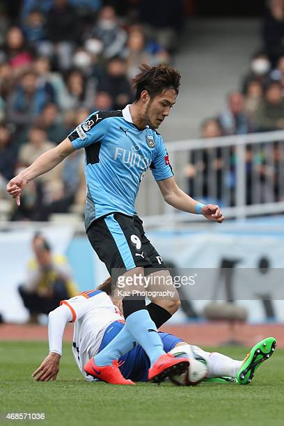 Kenyu Sugimoto of Kawasaki Frontale scores his team's first goal during the JLeague match between Kawasaki Frontale and Albirex Niigata at Todoroki...