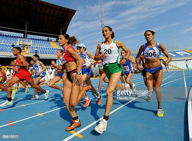 Kenza Dahmani Eps Tifani of Algerie and Anna Incerti of Italy compete in the Half Marathon during the XVI Mediterranean Games on July 3 2009 in...