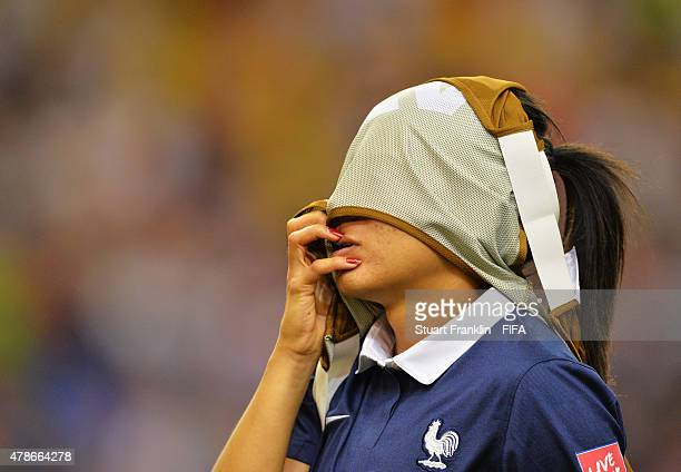 Kenza Dali of France looks dejected after her team lost in a penalty shootout during the quarter final match of the FIFA Women's World Cup between...