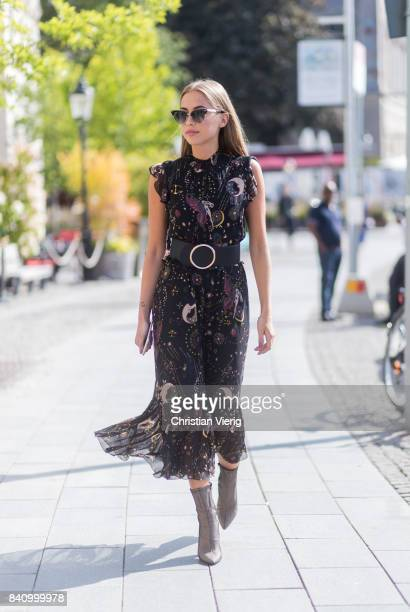 Kenza Zouiten Subosic wearing a dress with belt Chloe backpack outside Whyred on August 30 2017 in Stockholm Sweden