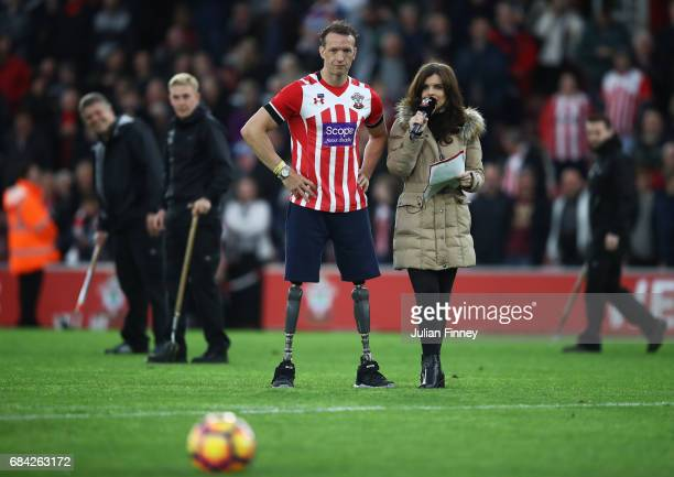 Kenzie Benali Southampton match day presentor speaks with Paralympian Richard Whitehead at half time during the Premier League match between...