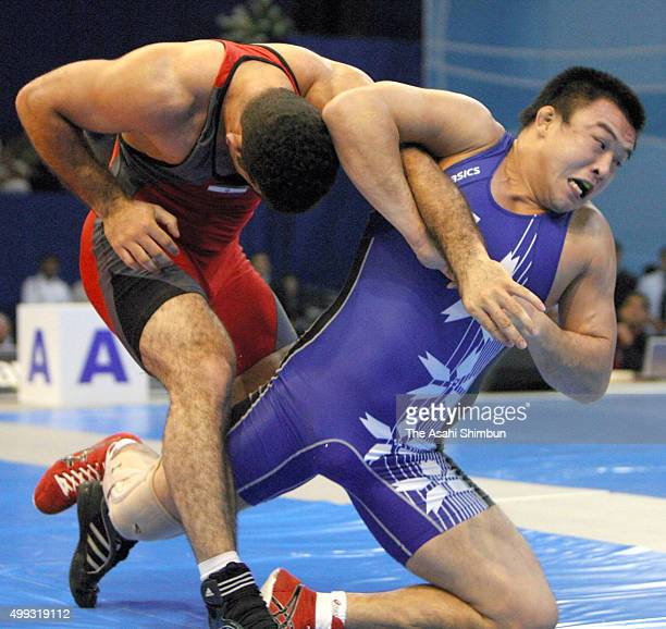 Kenzo Kato of Japan and Ghasem Rezaei of Iran compete in the Men's GrecoRoman 96kg bronze medal match during day two of the FILA Wrestling World...
