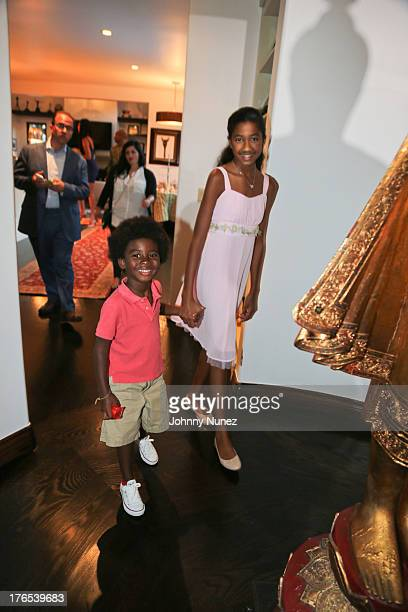 Kenzo Lee Hounsou and Aoki Simmons attend the Foundation For Ethnic Understanding Benefit on August 14 2013 in West Hollywood California