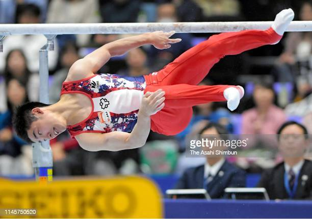 Kenzo Shirai competes on the Parallel Bars of the Men's Final on day three of the 73rd All Japan Artistic Gymnastics Individual AllAround...