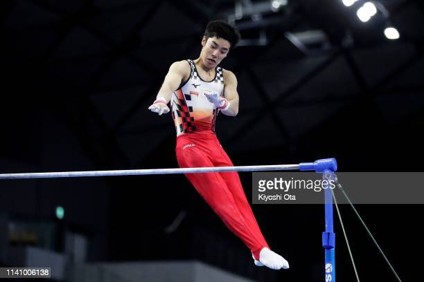 Kenzo Shirai of Japan competes in the Men's Horizontal Bar during the FIG Artistic Gymnastics AllAround World Cup Tokyo at Musashino Forest Sport...