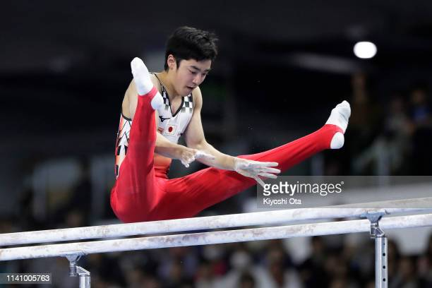 Kenzo Shirai of Japan competes in the Men's Parallel Bars during the FIG Artistic Gymnastics AllAround World Cup Tokyo at Musashino Forest Sport...