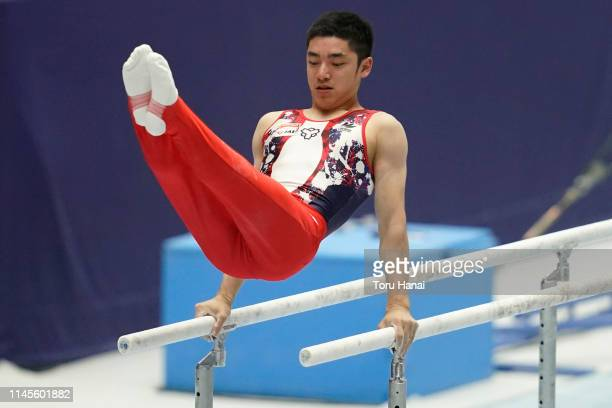 Kenzo Shirai of Japan competes on the parallel bars during day three of the 73rd All Japan Artistic Gymnastics Individual AllAround Championships at...