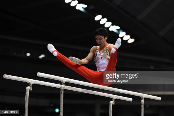Kenzo Shirai of Japan competes on the parallel bars during the FIG Individual AllAround World Cup at the Tokyo Metropolitan Gymnasium on April 14...