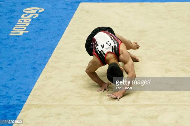 Kenzo Shirai of Japan falls as he competes on the floor during day one of the 73rd All Japan Artistic Gymnastics Individual AllAround Championships...