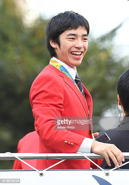 Kenzo Shirai smiles on the top of a double decker bus during the Rio Olympic Paralympic 2016 Japanese medalist parade in the ginza district on...
