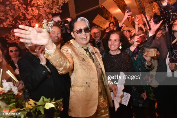 Kenzo Takada and guest release butterflies during the birthday cake illumintion during the Kenzo Takada Birthday Party as part of the Paris Fashion...