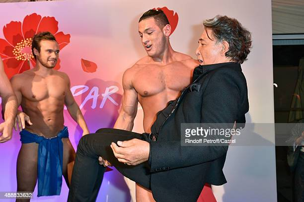 Kenzo Takada dancing with Gogo Dancers during the Kenzo Takada's 50 Years Of Life in Paris Celebration at Restaurant Le Pre Catelan on September 17...