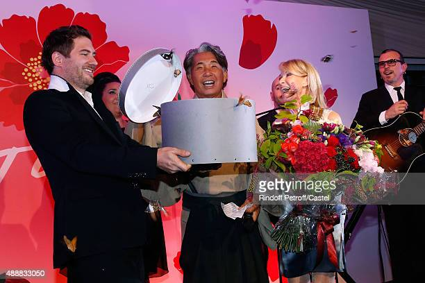 Kenzo Takada opens a gift box freeing 200 Butterflies during the Kenzo Takada's 50 Years Of Life in Paris Celebration at Restaurant Le Pre Catelan on...
