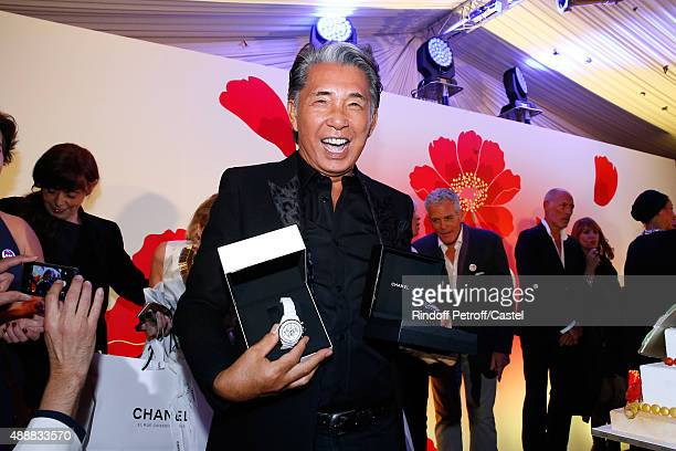 Kenzo Takada opens a gift from Karl Lagerfeld with to 'Chanel Watches' during the Kenzo Takada's 50 Years Of Life in Paris Celebration at Restaurant...
