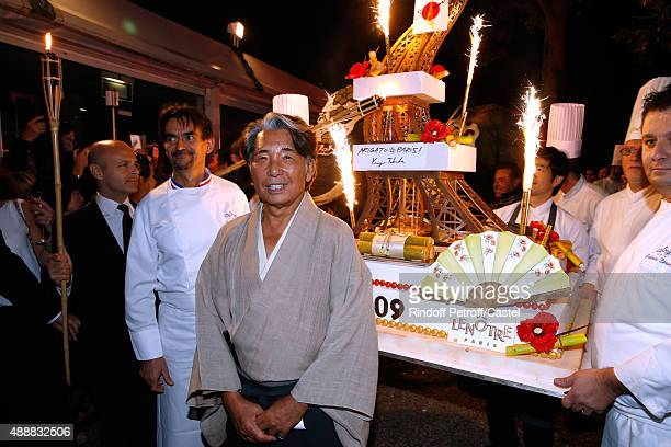 Kenzo Takada poses with Chef Guy Krenzer in front of his Birthday Cake during the Kenzo Takada's 50 Years of Life in Paris Celebration at Restaurant...