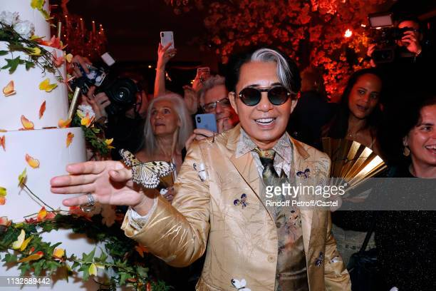 Kenzo Takada posing with a butterfly during he celebrates his 80th Birthday at Pavillon Ledoyen on February 28 2019 in Paris France
