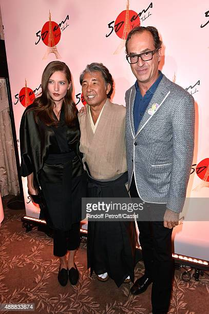 Kenzo Takada standing between Emmanuel de Brantes and Hea Deville attend the Kenzo Takada's 50 Years of Life in Paris Celebration at Restaurant Le...