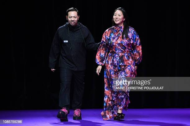 Kenzo's fashion designers Humberto Leon and Carol Lim greet the public at the end of the show during the men's Fall/Winter 2019/2020 collection...
