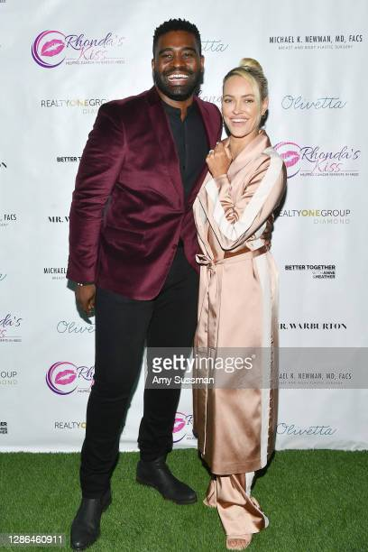 Keo Motsepe and Peta Murgatroyd attend Kiss The Stars Breast Cancer Awareness Cocktail Hour hosted by Anne Heche and presented by Mr. Warburton at...
