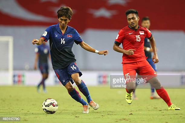 Keo Sokpheng of Cambodia goes after the ball against Muhammad Izzdin Shafiq Bin Yacob of Singapore during the FIFA 2018 World Cup Qualifier match...