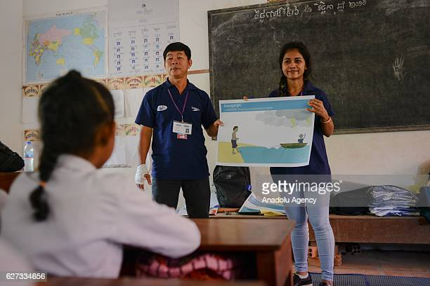 Keo Sopheap and Chan Sovanna from Safety When It Matters Cambodia teach children the dangers of water during a safety and drowning prevention class...