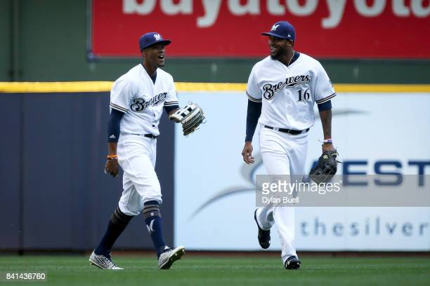 Keon Broxton and Domingo Santana of the Milwaukee Brewers celebrate after beating the St Louis Cardinals 65 at Miller Park on August 30 2017 in...