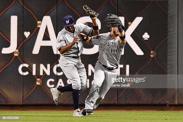 Keon Broxton and Kirk Nieuwenhuis of the Milwaukee Brewers collide after Nieuwenhuis caught a fly ball in the third inning against the Cincinnati...