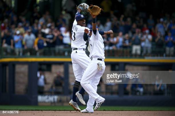 Keon Broxton and Orlando Arcia of the Milwaukee Brewers celebrate after beating the St Louis Cardinals 65 at Miller Park on August 30 2017 in...