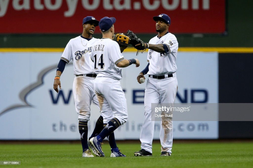 Keon Broxton #23, Hernan Perez #14 and Domingo Santana #16 of the Milwaukee Brewers celebrate after defeating the Boston Red Sox 7-4 at Miller Park on May 10, 2017 in Milwaukee, Wisconsin.