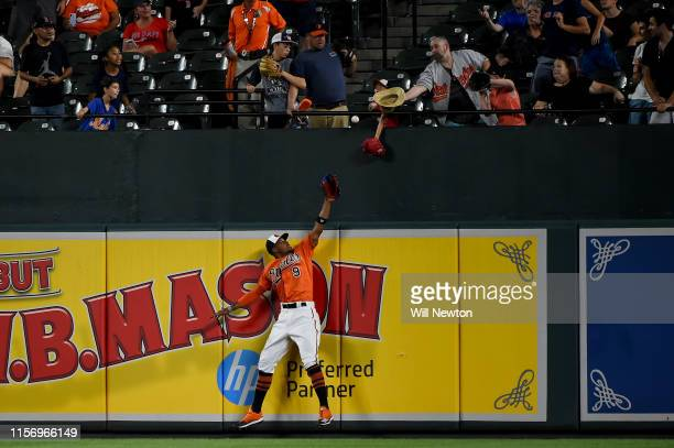 Keon Broxton of the Baltimore Orioles can not make the catch of the home run hit by Sandy Leon of the Boston Red Sox during the ninth inning at...