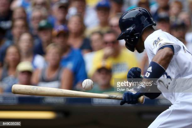 Keon Broxton of the Milwaukee Brewers attempts a bunt in the fourth inning against the Miami Marlins at Miller Park on September 17 2017 in Milwaukee...