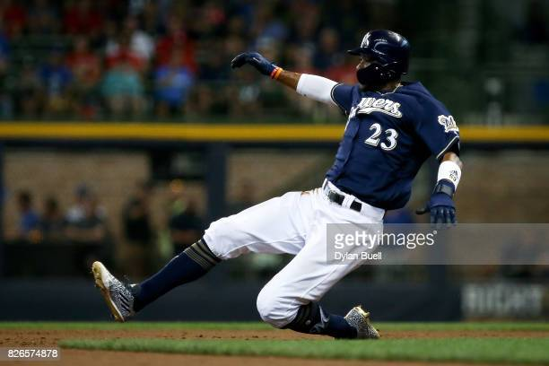 Keon Broxton of the Milwaukee Brewers attempts to steal second base in the second inning against the St Louis Cardinals at Miller Park on August 3...