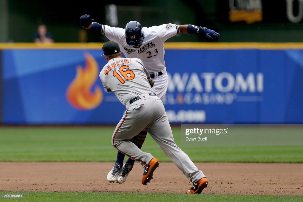 Keon Broxton #23 of the Milwaukee Brewers avoids a tag attempt by Trey Mancini #16 of the Baltimore Orioles during a run down in the second inning at Miller Park on July 5, 2017 in Milwaukee, Wisconsin.