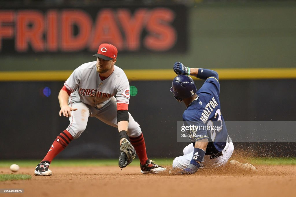 Keon Broxton #23 of the Milwaukee Brewers beats a tag at second base by Zack Cozart #2 of the Cincinnati Reds during the seventh inning of a game at Miller Park on September 26, 2017 in Milwaukee, Wisconsin.