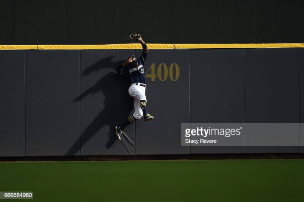 Keon Broxton of the Milwaukee Brewers catches a fly ball against the wall during the ninth inning of a game against the Chicago Cubs at Miller Park...