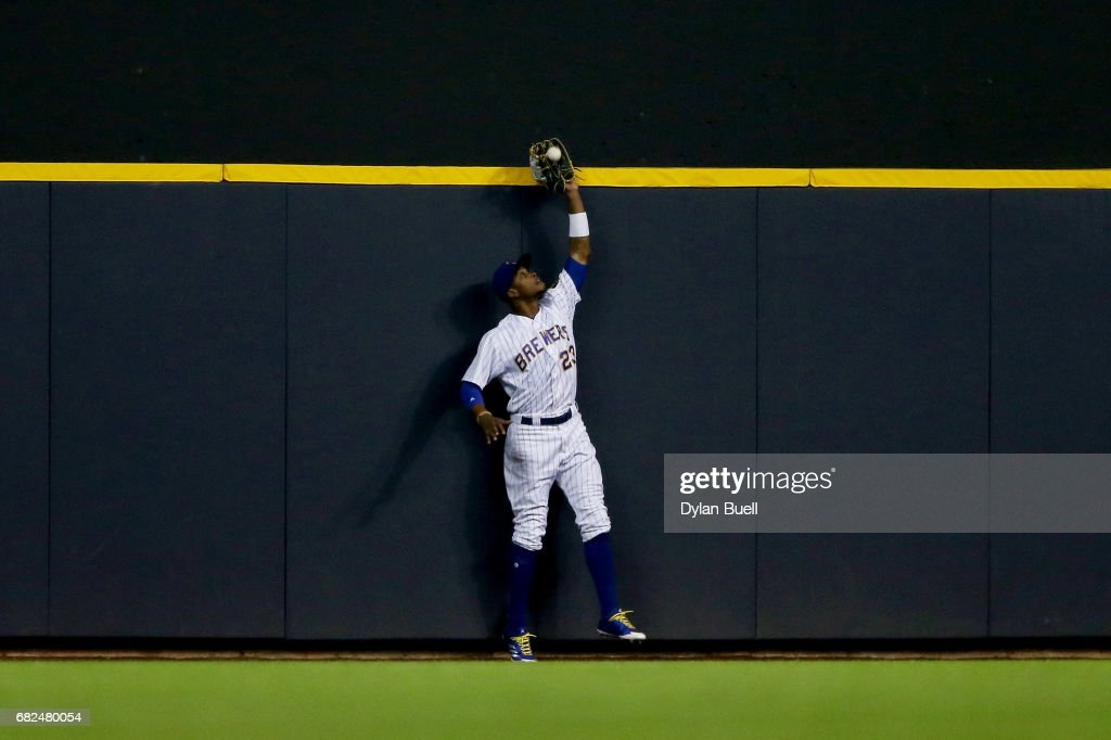 Keon Broxton #23 of the Milwaukee Brewers catches a fly ball at the wall in the sixth inning against the New York Mets at Miller Park on May 12, 2017 in Milwaukee, Wisconsin.