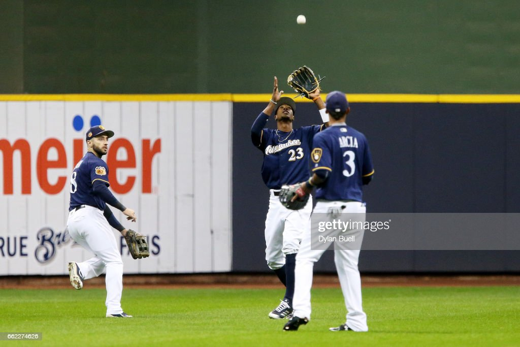 Keon Broxton #23 of the Milwaukee Brewers catches a fly ball in the first inning against the Chicago White Sox as Ryan Braun #8 and Orlando Arcia #3 look on during an exhibition game at Miller Park on March 31, 2017 in Milwaukee, Wisconsin.