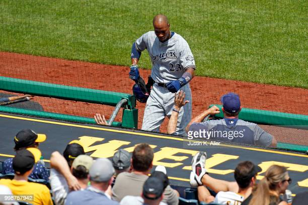 Keon Broxton of the Milwaukee Brewers celebrates after scoring on a RBI single in the fifth inning during game one of a doubleheader against the...