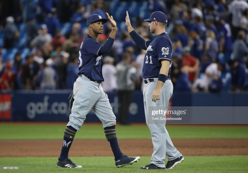 Keon Broxton #23 of the Milwaukee Brewers celebrates their victory with Travis Shaw #21 during MLB game action against the Toronto Blue Jays at Rogers Centre on April 11, 2017 in Toronto, Canada.