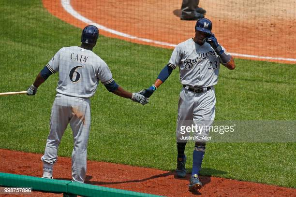 Keon Broxton of the Milwaukee Brewers celebrates with Lorenzo Cain of the Milwaukee Brewers after hitting a RBI single in the fifth inning during...