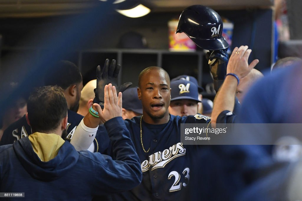 Keon Broxton #23 of the Milwaukee Brewers is congratulated by teammates after scoring a run during the seventh inning of a game against the Chicago Cubs at Miller Park on September 21, 2017 in Milwaukee, Wisconsin.