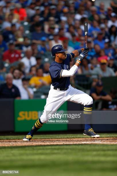 Keon Broxton of the Milwaukee Brewers makes some contact at the plate during the game against the Washington Nationals at Miller Park on September 03...