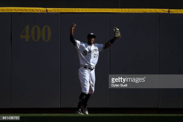 Keon Broxton of the Milwaukee Brewers reacts after catching a fly ball to end the game against the St Louis Cardinals at Miller Park on August 30...